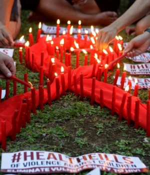 People light candles to mark World AIDS day in Quezon city, Metro Manila, Philippines