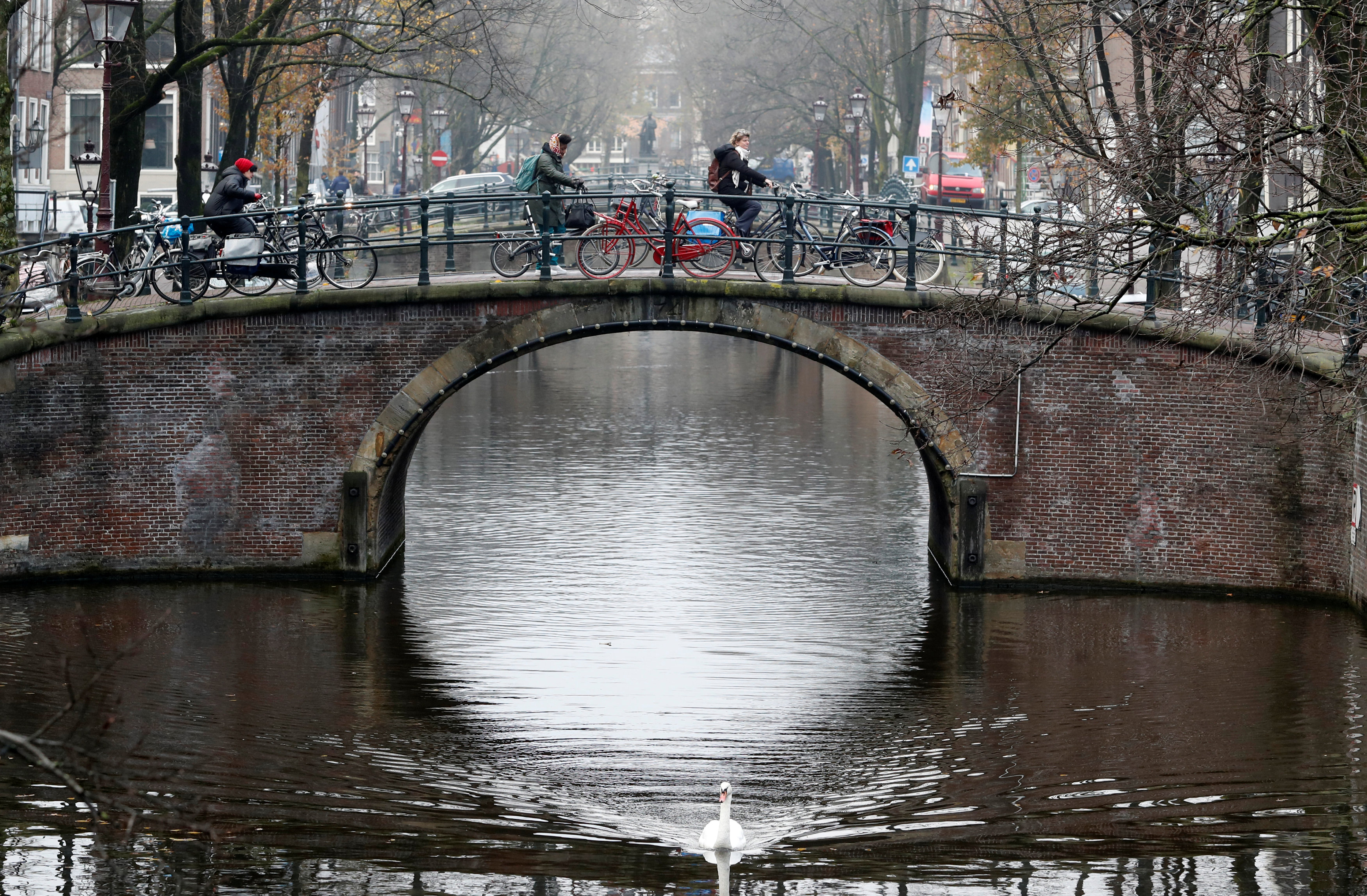 A cyclist ride on a bridge in central Amsterdam