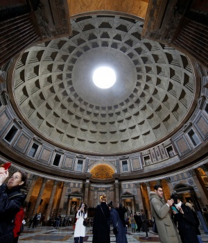 Tourists visit the ancient Pantheon in downtown Rome