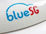 A BlueSG logo is pictured on an electric car-sharing vehicle parked at a charging station in a public housing estate in Singapore