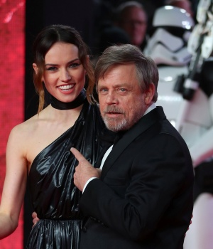 Actors Daisy Ridley and Mark Hamill pose for photographers as they arrive for the European Premiere of 'Star Wars: The Last Jedi', at the Royal Albert Hall in central London
