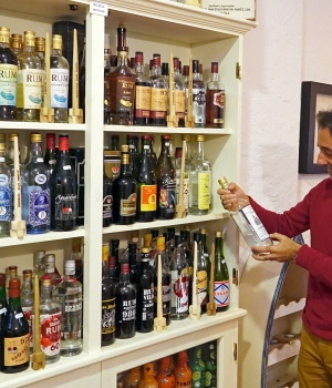 Roberto Andrade, who runs the Madeira Rum House, poses with his collection of rums in Funchal