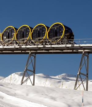Barrel-shaped carriages of a new funicular line are seen in Stoos