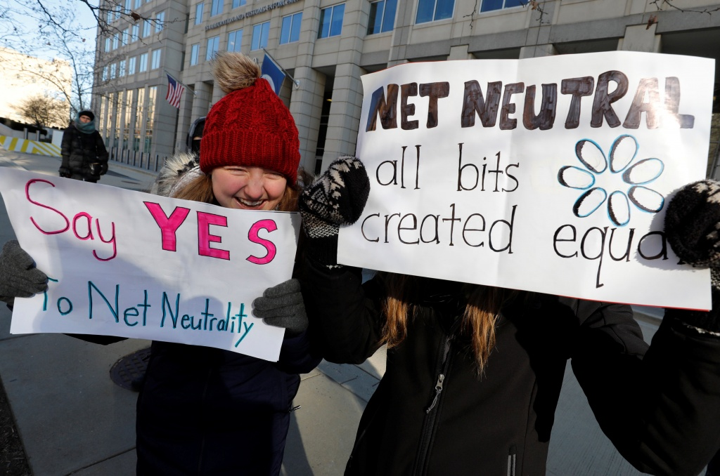 Net neutrality advocates rally in front of the Federal Communications Commission in Washington