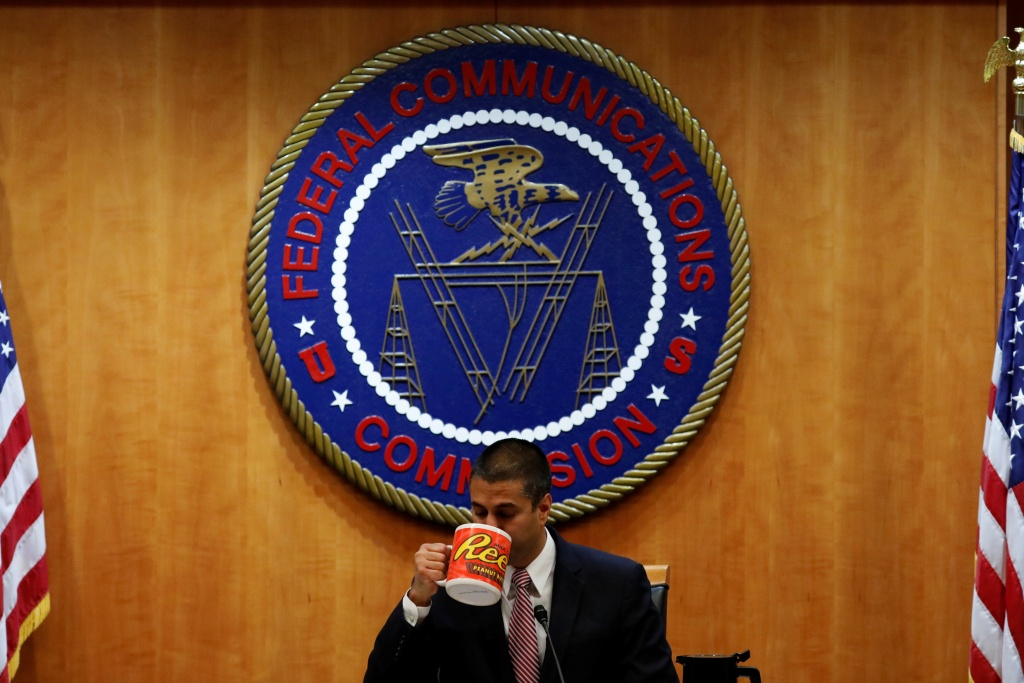 Chairman Ajit Paid drinks coffee ahead of the vote on the repeal of so called net neutrality rules at the Federal Communications Commission in Washington