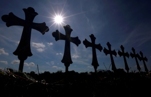 Crosses are seen placed at a memorial in memory of the victims killed in the shooting at the First Baptist Church of Sutherland Springs