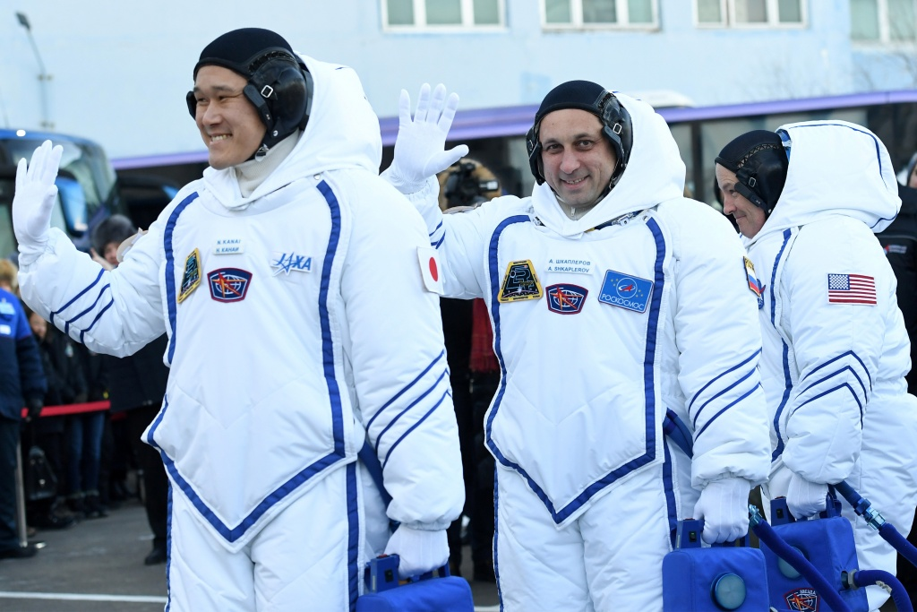 Members of the International Space Station expedition 54/55 during the send-off ceremony after checking their space suits before the launch of the Soyuz MS-07 spacecraft at the Baikonur cosmodrome