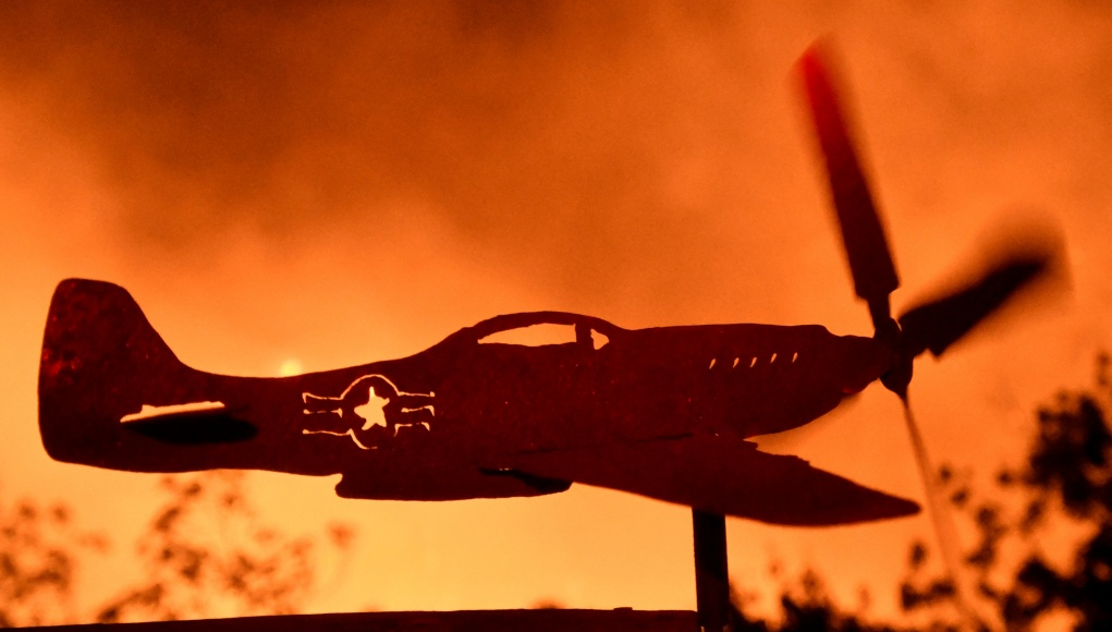An airplane weather-vain propeller spins from the heavy winds from the Thomas Fire in the hills outside Montecito California