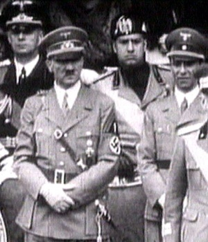 King Victor Emanuel III, Adolf Hitler and Benito Mussolini watch fascist troops march past from a balcony in central Rome in this still image taken from 1941 television file footage