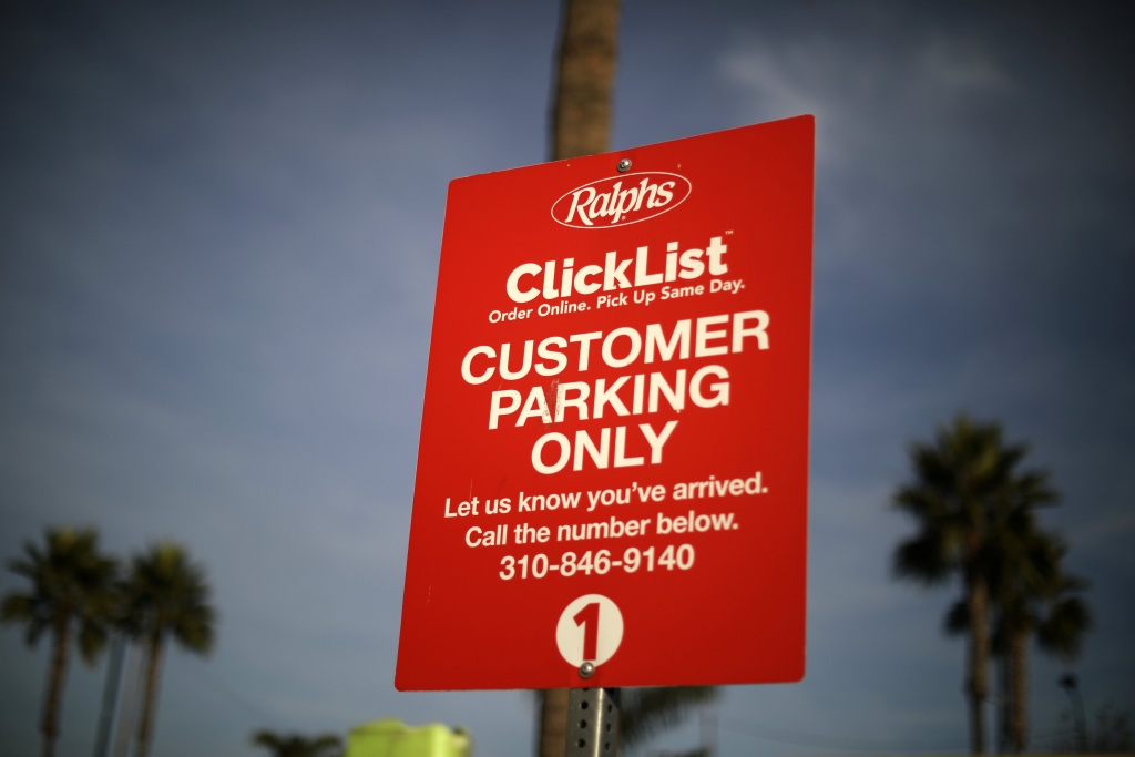 A sign for the Kroger's ClickList online ordering and curbside pickup service is seen at Ralph's grocery store in Los Angeles