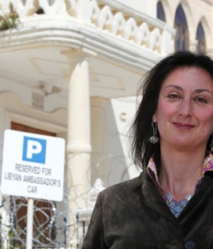 Maltese investigative journalist Daphne Caruana Galizia poses outside the Libyan Embassy in Valletta