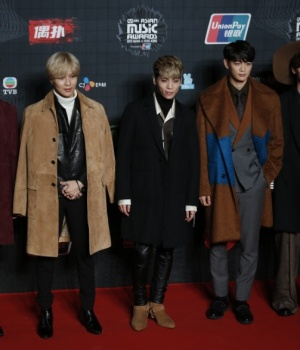 Members of South Korean K-Pop band SHINee pose on the red carpet during 2015 Mnet Asian Music Awards in Hong Kong