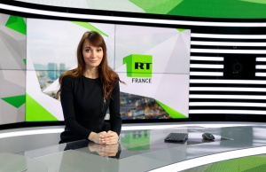 """Xenia Fedorova, chief executive of RT France, of the Russian state broadcaster RT, formerly known as """"Russian Today"""", poses during a visit to their news studio in Boulogne-Billancourt"""