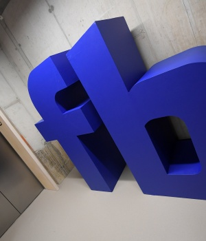 A giant logo is seen at Facebook's head