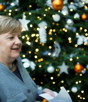 Acting German Chancellor Angela Merkel leaves after a news conference at the Christian Democratic Union (CDU) party headquarters in Berlin
