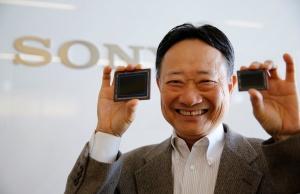 Shimizu, chief of Sony's chip division, poses with Sony's image sensors after an interview with Reuters in Tokyo