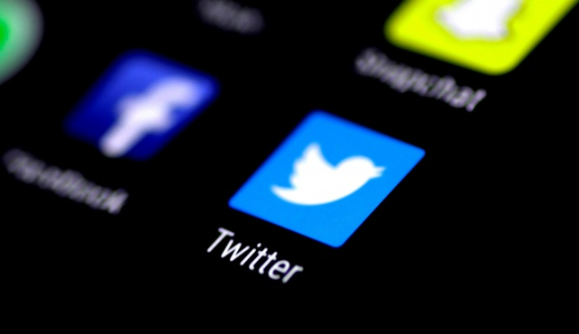 The Twitter application is seen on a phone screen