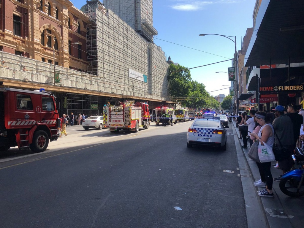 Emergency cars are seen on the street following the incident outside Flinders St station in Melbourne
