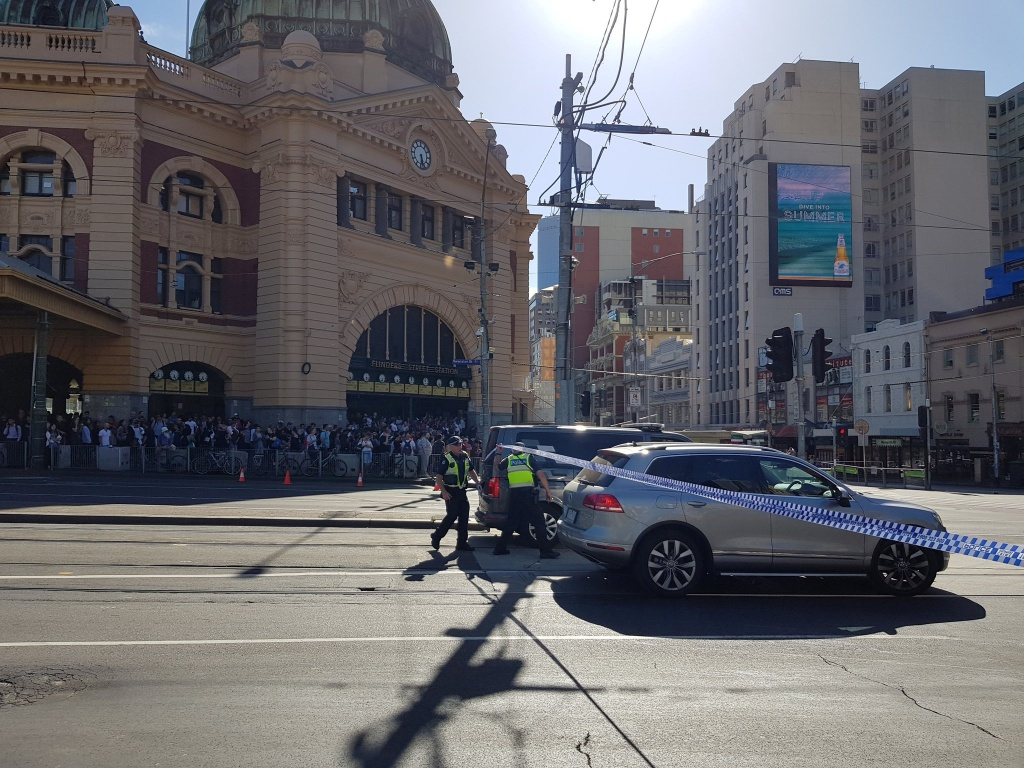 Flinders St station is blocked by the police following the car incident in Melbourne