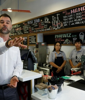 Ducatus CEO Ronny Tome speaks during the opening of their cashless cafe that accepts cryptocurrencies such as Bitcoin in Singapore