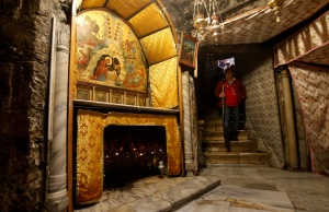 Visitor walks in the cave, where Virgin Mary is believed to have given birth to Jesus, inside the Church of the Nativity in the West Bank town of Bethlehem