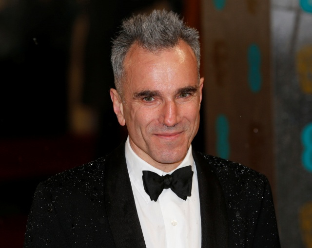 Day-Lewis poses as he arrives for the British Academy of Film and Arts awards ceremony at the Royal Opera House in London