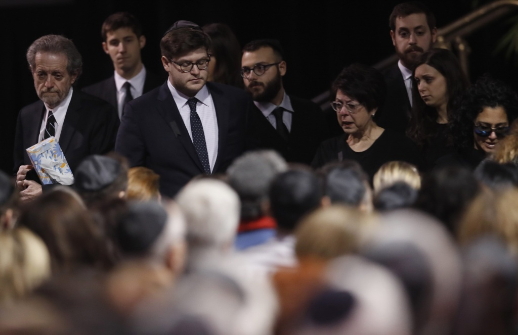 Mourners arrive at the memorial service for pharmaceutical billionaire Barry Sherman and his wife Honey in Toronto