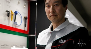 Hideaki Hikosaka, a member of NGK Spark Plug's solid-state battery R&D team, shows a prototype of its all solid-state battery under development during an interview with Reuters in Nagoya, Japan