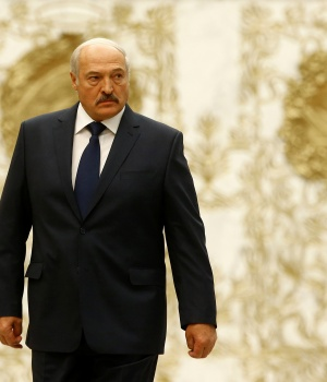 Belarussian President Lukashenko walks at the Independence Palace in Minsk