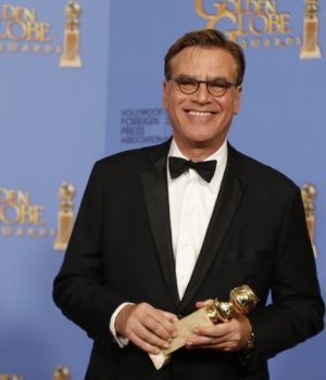 "Aaron Sorkin poses with the award for Best Screenplay - Motion Picture for ""Steve Jobs"" backstage at the 73rd Golden Globe Awards in Beverly Hills"