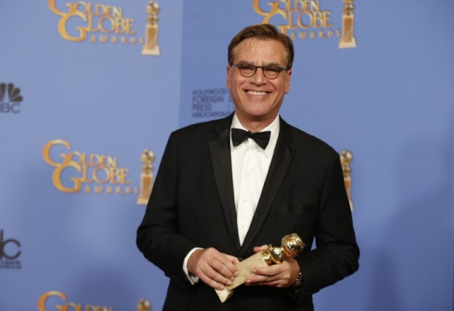 Aaron Sorkin poses with the award for Best Screenplay - Motion Picture for