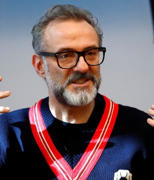Michelin-starred chef Massimo Bottura gestures during interview at Refettorio Ambrosiano in Milan