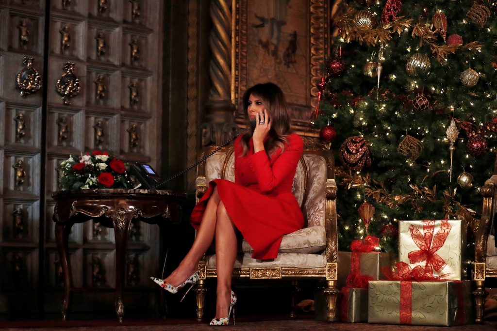 First Lady Melania Trump participates in NORAD (North American Aerospace Defense Command) Santa Tracker phone calls with children at Mar-a-Lago estate in Palm Beach, Florida