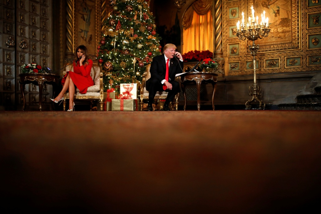U.S. President Donald Trump and First Lady Melania Trump participate in NORAD (North American Aerospace Defense Command) Santa Tracker phone calls with children at Mar-a-Lago estate in Palm Beach, Florida