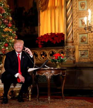 U.S. President Donald Trump participates in NORAD (North American Aerospace Defense Command) Santa Tracker phone calls with children at Mar-a-Lago estate in Palm Beach, Florida