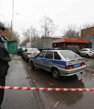 "A policeman stands guard after a gunman opened a fire in the pastry-making factory ""Menshevik"" in Moscow"