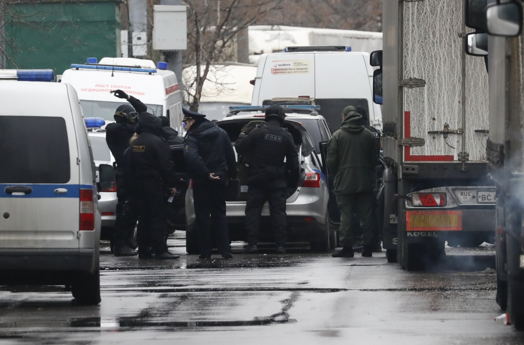 "Members of law enforcement services gather after a gunman opened a fire in the pastry-making factory ""Menshevik"" in Moscow"