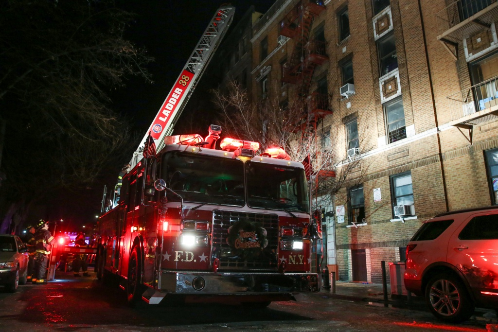 FDNY personnel work on the scene of an apartment fire in New York