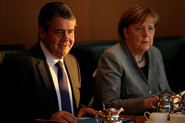 German Foreign Minister Sigmar Gabriel and Chancellor Angela Merkel attend the weekly cabinet meeting at the Chancellery in Berlin