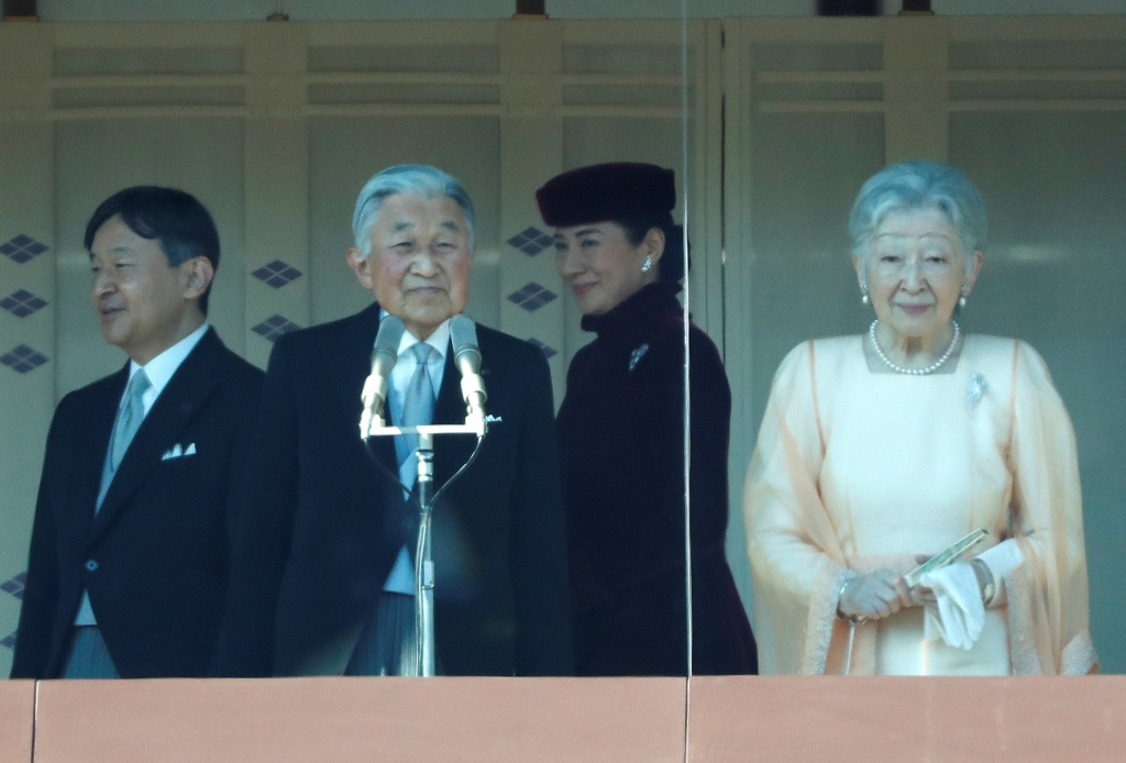 Japan's Emperor Akihito appears with Empress Michiko, Crown Prince Naruhito and Crown Princess Masako before well-wishers who gathered to celebrate the emepror's 84th birthday at the Imperial Palace in Tokyo