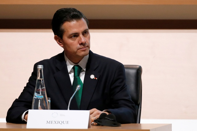 Mexican President Enrique Pena Nieto attends the Plenary Session of the One Planet Summit at the Seine Musicale venue in Boulogne-Billancourt