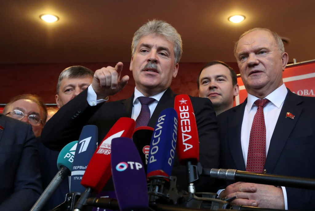 Pavel Grudinin, head of the Lenin State Farm and Communist Party presidential nominee talks to the media as he stands next to Russia's Communist Party leader Gennady Zyuganov after a party congress in Snegiri outside Moscow