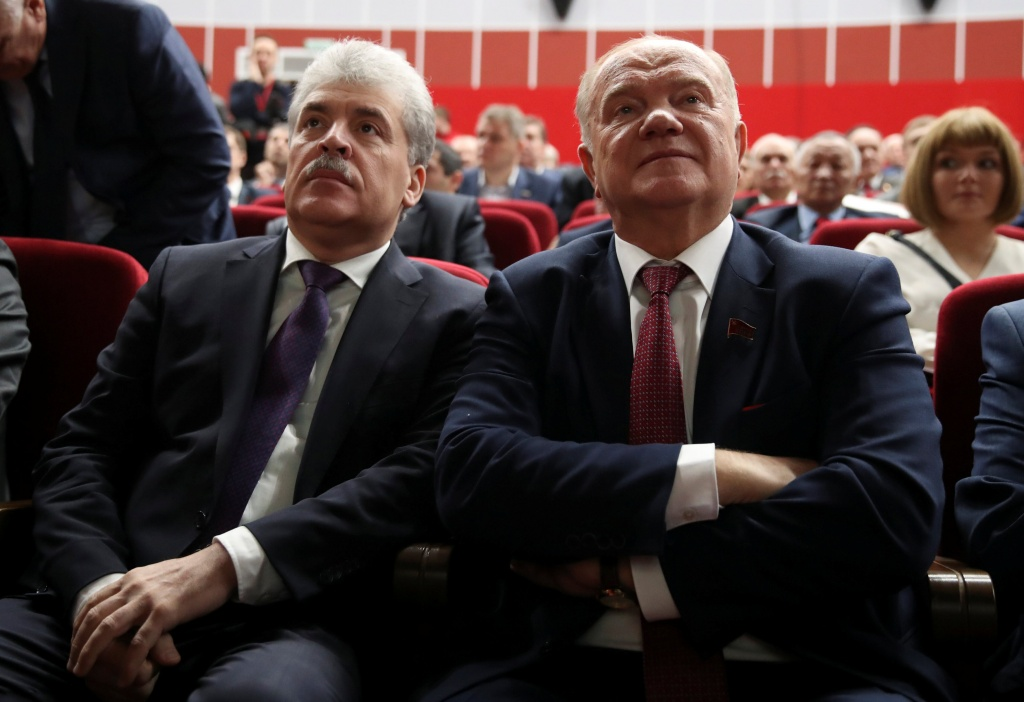 Russia's Communist Party leader Gennady Zyuganov and Pavel Grudinin, head of the Lenin State Farm, attend a party congress to nominate a candidate for presidency in Snegiri outside Moscow