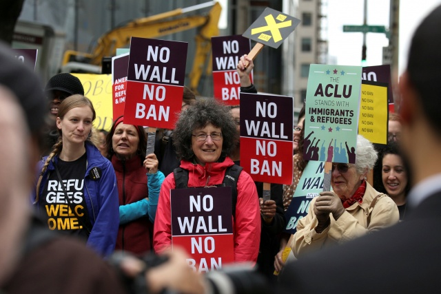 People protest U.S. President Donald Trump's travel ban outside of the U.S. Court of Appeals in Seattle
