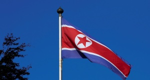 A North Korean flag flies on a mast at the Permanent Mission of North Korea in Geneva