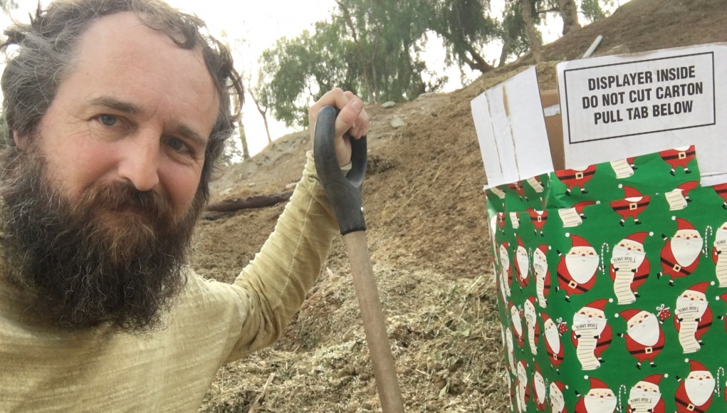 Robert Strong is seen next to a gift-wrapped box in this photo released by Robert Strong of Eagle Rock