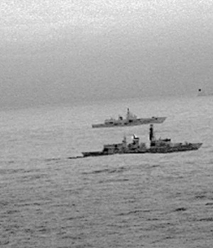 Images from an infrared camera on a helicopter show Royal Navy frigate HMS St Albans escorting Russian warship Admiral Gorshkov as it passes close to UK territorial waters through the North Sea in an image from an infrared camera on a helicopter handed out