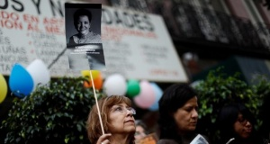 A journalist holds up a photo of journalist Miroslava Breach during a demonstration against the murder of journalists in Mexico, outside the building of Attention to Crimes against Freedom of Expression (FEADLE) in Mexico City