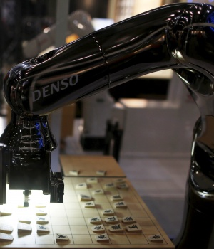 "Denso Corp's robot arm ""Denoute-san"" plays Japanese chess, also known as Shogi, at a booth during Niconico Chokaigi 2015 in Makuhari"