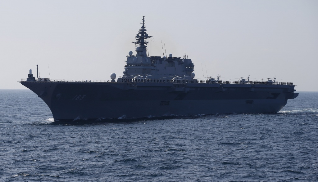 The Izumo military helicopter carrier of the Japan Maritime Self-Defense Force (JMSDF) sails during its fleet review at Sagami Bay, off Yokosuka